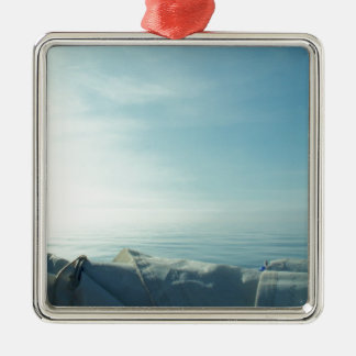 Vela cuidadosamente formada escamas adorno navideño cuadrado de metal