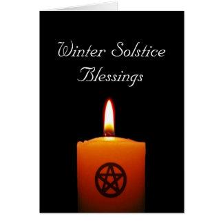 Vela pagana del solsticio de invierno con la tarjeta de felicitación
