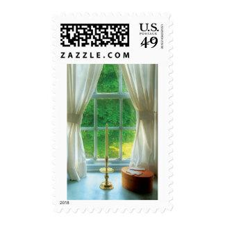 Vela - todavía vida en una ventana sello