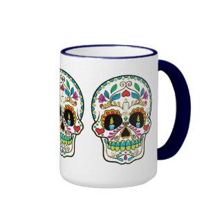 Velas ardientes del cráneo floral colorido del taza de dos colores