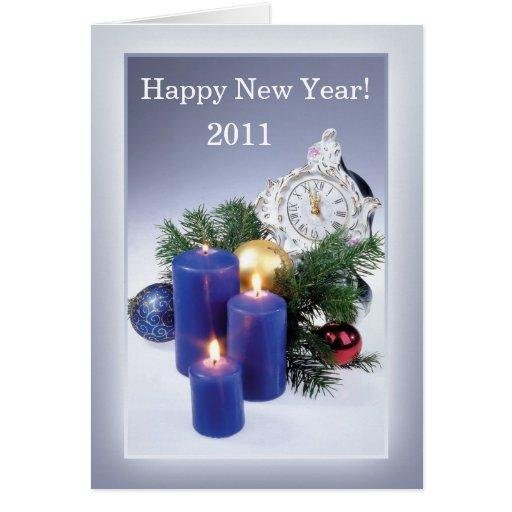 Velas, tarjeta del Año Nuevo del reloj