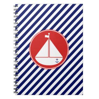 Velero azul y rojo cuaderno