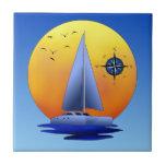 Velero del catamarán y rosa de compás azulejo ceramica