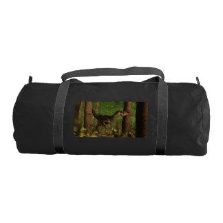 Velociraptor dinosaur in the forest gym bag
