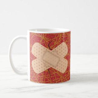 Vendaje en una grieta taza