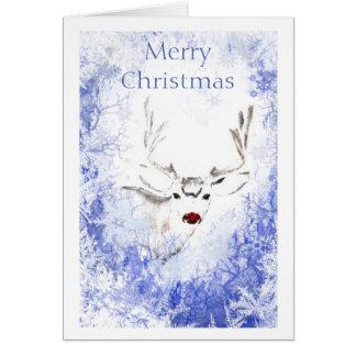 Ventana escarchada del reno con la nariz roja de tarjeta de felicitación
