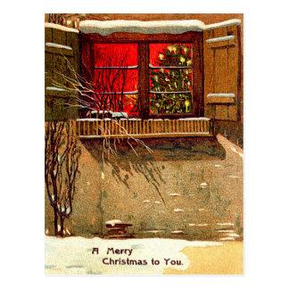 Ventana iluminada por velas del árbol de navidad postal