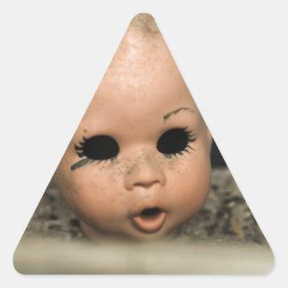 Ventana sucia de la cabeza de la muñeca del pegatina triangular