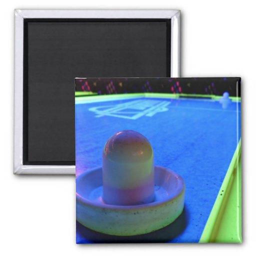 Ventile la tabla y el mazo del hockey con la ilumi iman de nevera