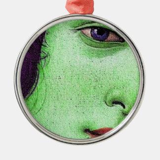 Venus in green metal ornament