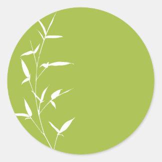 Verde de bambú de la plantilla del fondo de la etiqueta redonda