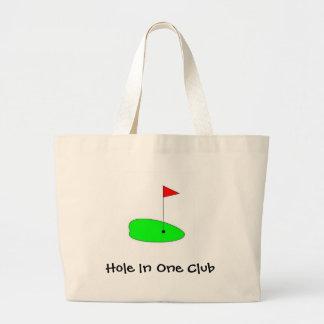 verde del golf, agujero en un club bolsas de mano