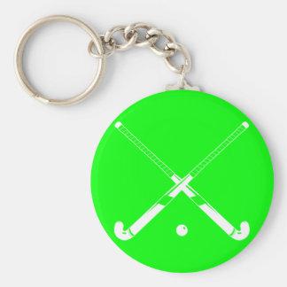 Verde del llavero de la silueta del hockey hierba