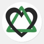 Verde del negro del triángulo de la adopción pegatina redonda