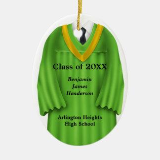 Verde masculino del vestido del graduado y ornamen ornato