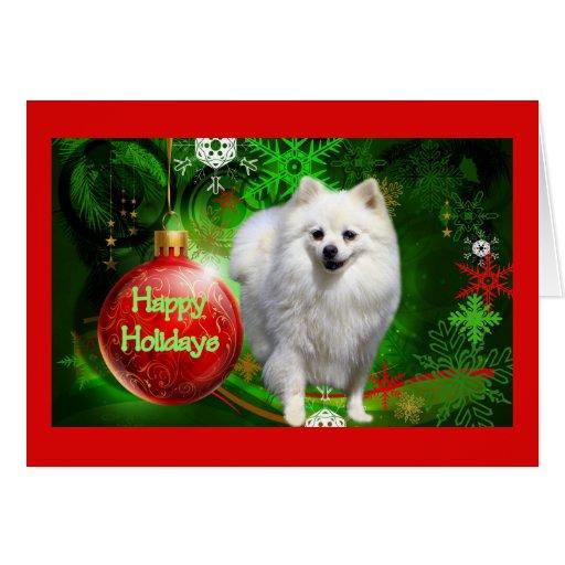 Verde rojo de la bola de la tarjeta de Navidad de