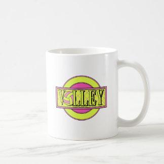 verde rosado y amarillo del logotipo del voleo taza