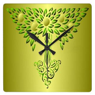 Verde y árbol del oro del reloj de pared de la vid