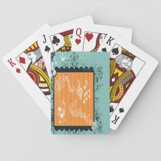 Verde y naipes musicales anaranjados del diseño barajas de cartas