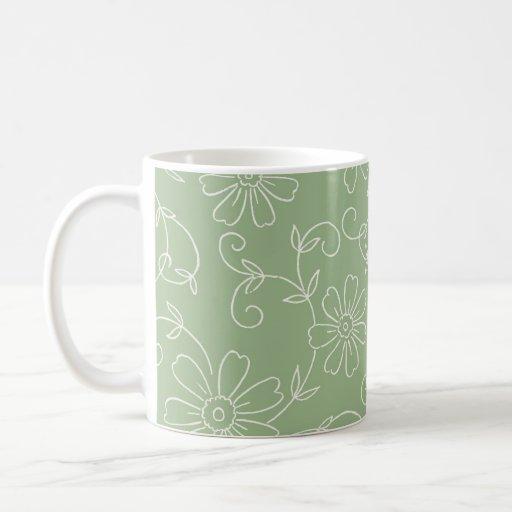 Verde y taza de café floral de la crema