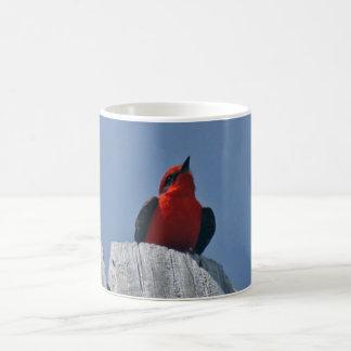 Vermillion Flycatcher against blue sky coffee mug