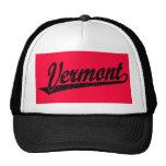 Vermont script logo in black distressed trucker hat