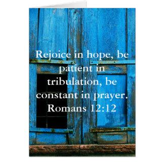 Verso de la biblia del 12:12 de los romanos sobre tarjeta de felicitación