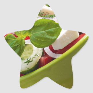 Vertical view close-up on a green bowl with salad star sticker