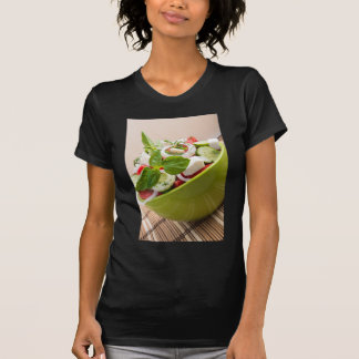 Vertical view close-up on a green bowl with salad T-Shirt
