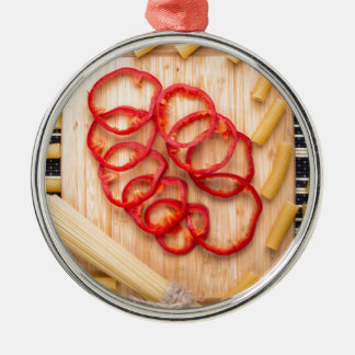 Vertical view on food background from pasta metal ornament