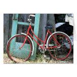 Vertiente vieja de ciclo que monta en bicicleta de tarjetas