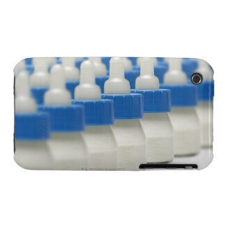 Very small feeding bottles in perspective, shot Case-Mate iPhone 3 cases
