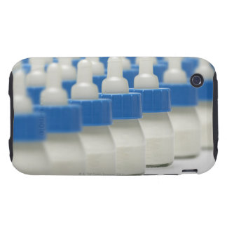 Very small feeding bottles in perspective, shot iPhone 3 tough case