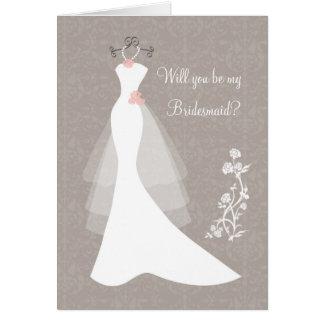 Vestido de boda blanco en la petición marrón de la felicitación