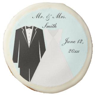 Vestido de boda y galleta del boda del smoking