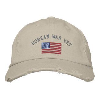 Veterinario coreano con la bandera americana gorra de beisbol