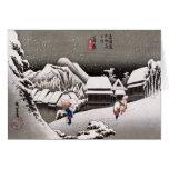 Viajeros en la nieve en la estación de Kanbara Felicitación
