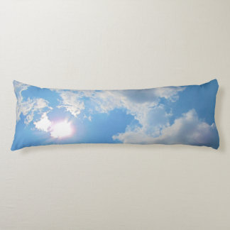 Vibrant blue sky with sun and clouds photo body pillow