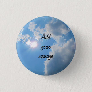 Vibrant blue sky with sun and clouds photo pinback button