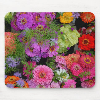 Vibrant colored daisies mouse pad