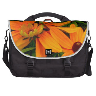 Vibrant colorful yellow flowers in full bloom computer bag