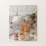 """Vibrant English Tea, Fondant Fancies Puzzle<br><div class=""""desc"""">A beautiful image for a jigsaw with lots of detail. Our now familiar afternoon tea,  featuring lots of gold,  colourful cakes,  pink flowers and silverware,  a really lovely gift or great re-sale product.</div>"""
