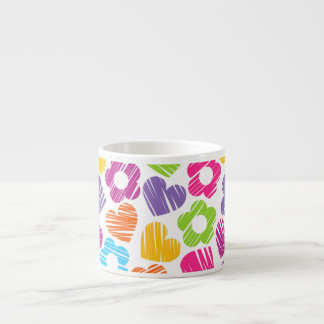 Vibrant freehand drawn flowers and hearts espresso cup