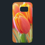 """Vibrant Orange Tulip Flowers Close-Up Photograph Samsung Galaxy S7 Case<br><div class=""""desc"""">Focus on this close-up floral photo is on the forward vibrant yellow edged orange tulip with others in the background. Click customize to add text in a font style,  size and color you prefer.</div>"""
