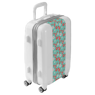 Vibrant red koi fish swimming on mint pattern luggage