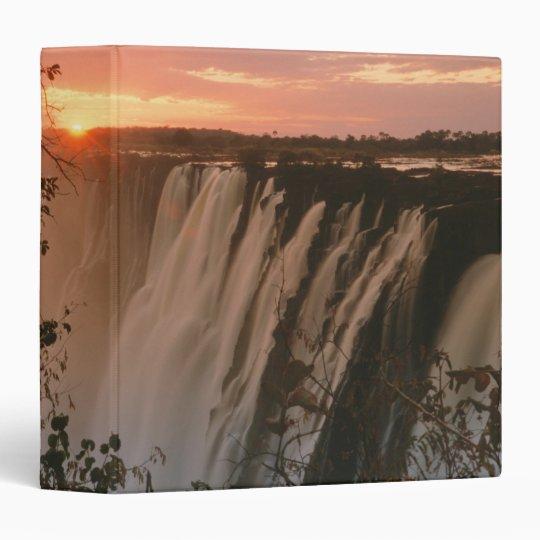Victoria Falls with sun on horizon, Victoria Binder