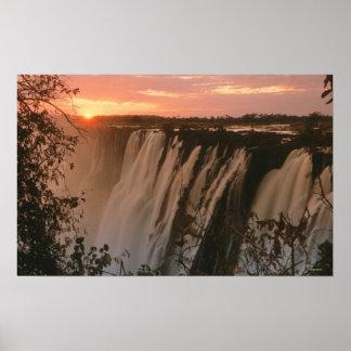 Victoria Falls with sun on horizon, Victoria Poster