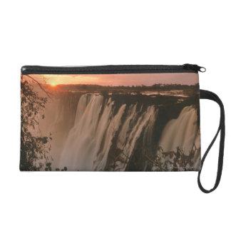 Victoria Falls with sun on horizon, Victoria Wristlet