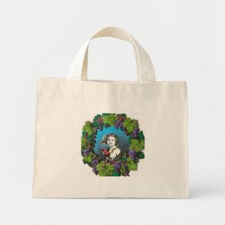 Victorian style boy in grape wreath mini tote bag