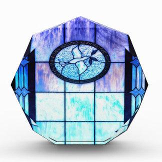 Vidrio azul de la mancha con la paloma
